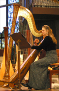 Performing on the harp in Los Altos